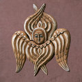 Decorative angel on the maroon wall for design Stock Photo