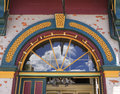 Decorative arched doorway brightly painted original antique with glass fanlight above Royalty Free Stock Photo