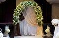 Decorative arched white floral bridal bower