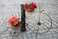 Decorative bicycle metal with pots of colorful flowers Stock Photo