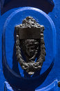 Decorative bronze door handle in the form of a beautiful woman`s Royalty Free Stock Photo