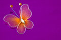 Decorative butterfly wire and nylon on purple background with copy space Stock Photo