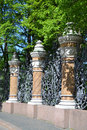 Decorative cast iron fence of mikhailovsky garden in st petersburg russia Stock Photos