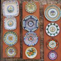 Decorative ceramics sienna ceramic plates with elaborate traditional designs for sale in old town italy Royalty Free Stock Images