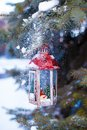 Decorative Christmas lantern on fir branch in snow Royalty Free Stock Photo