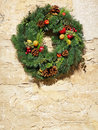 Decorative Christmas wreath on vintage stone wall Stock Photos