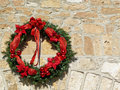 Decorative Christmas wreath on vintage stone wall Royalty Free Stock Photos