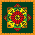 Decorative colorful ethnic rosette on a dark green background Royalty Free Stock Photo
