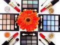 Decorative cosmetics and flower. Stock Photography