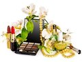 Decorative cosmetics and flower. Royalty Free Stock Image