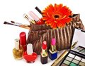 Decorative cosmetics and flower. Royalty Free Stock Photography