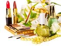 Decorative cosmetics and flower. Stock Photos