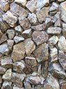 Decorative cracked real stone wall surface with cement Royalty Free Stock Photo