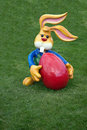 Decorative Easter bunny holding a big red egg Royalty Free Stock Photo
