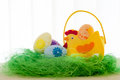 Decorative eggs on green grass. Chicken basket. Concepts Easter, eggs, hand made morning Royalty Free Stock Photo