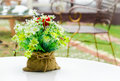 Decorative flower in sack on white table Royalty Free Stock Photography