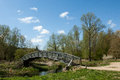 Decorative footbridge over a main river in spring sunshine Stock Images