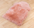 Decorative fur carpet Stock Photos