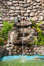 Decorative garden waterfall Royalty Free Stock Photo