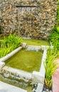Decorative garden waterfall. Royalty Free Stock Photo