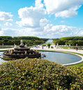 Decorative gardens & fountain with bright blue sky Royalty Free Stock Images