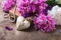 Decorative heart and splendid pink and white peonies flowers on aged wooden background vintage background selective focus Royalty Free Stock Photography
