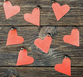 Decorative hearts toys hanging on a wooden background Stock Images