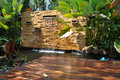Decorative home garden stone waterfall pond Royalty Free Stock Photo