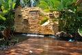 Decorative home garden stone waterfall pond Royalty Free Stock Photo