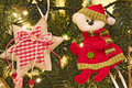 Decorative items on christmas tree closeup of fabric hung up with lights Royalty Free Stock Images