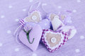 Decorative lavender hearts on lavender background Royalty Free Stock Photography