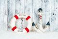 Decorative lifebuoy, anchor and starfish sea shells over wooden blue background Royalty Free Stock Photo