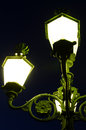 Decorative lit lamp post Stock Photo