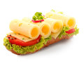 Open baguette sandwich with rolled cheese Royalty Free Stock Photo