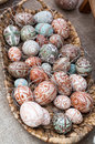 Decorative painted easter eggs wicker basket sale crafts market Stock Photo