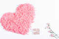 Decorative pink heart, small box with a gift and ribbon and flow Royalty Free Stock Photo