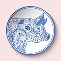 Decorative plate with blue patterned head of a pig. Symbol of new year 2019 isolated on pink background Royalty Free Stock Photo