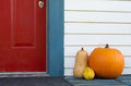 Decorative pumpkin and gourds on the front porch of a house Royalty Free Stock Photo