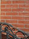 Decorative railing, brick wall Stock Photo