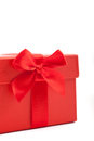 Decorative red fabric bow on an ornamental christmas or valentines gift box close up view of the over a white background to Royalty Free Stock Photos