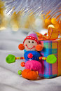 Decorative snowman with present box Stock Photos
