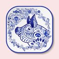 Decorative square plate with blue patterned head of a pig. Symbol of new year 2019 isolated on pink background Royalty Free Stock Photo