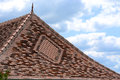 Decorative tiled roof with finial. Royalty Free Stock Photo