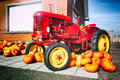 Decorative tractor and fresh pumpkins for sale Stock Image