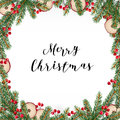 Decorative traditional Merry Christmas frame, wreath. Fir, spruce green branches decorated with red berries and dried apples Royalty Free Stock Photo