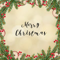 Decorative traditional Merry Christmas frame, wreath. Fir, spruce green branches decorated with red berries and dried apples. Royalty Free Stock Photo
