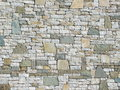 A decorative wall as background with stone of different size and colour to be used Royalty Free Stock Images