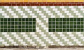 Decorative wall with ceramic tiles and glass block Royalty Free Stock Photo