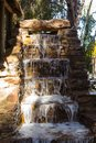 Decorative stone waterfall Royalty Free Stock Photo