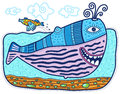 Decorative whale and little fish large swimming smiling the jumping over it clouds float across the sky Stock Photo